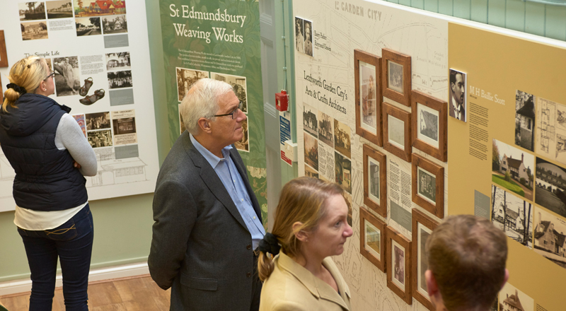 Image of people looking at exhibition design panel