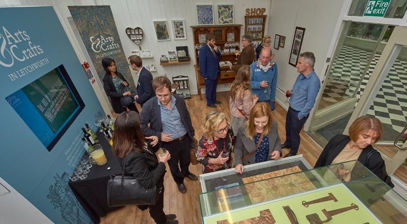 Image of visitors to Arts & Crafts in Letchworth exhibition design